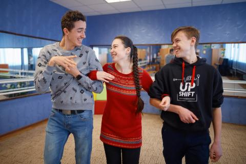 Volodymyr Charushyn, 16, Maria Shatalova, 17, and Fedir Stadnyk, 15, in a dancing room at their education complex for children with hearing disabilities in Kharkiv, Ukraine, on 18 February 2019. These three cheerful friends are working on building a bridge between hearing and non-hearing people in their home city with the help of UPSHIFT Ukraine programme.