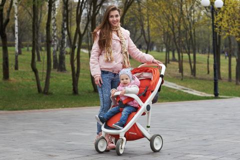 Olena Kudryashova and her 17-month-old daughter Maya enjoy a walk in the park outside their home in Kyiv.