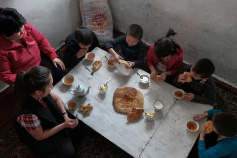 family eating at home in a low-income neighbourhood_Alimzhan Jorobayev