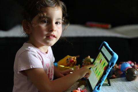 Girl with a tablet communicator