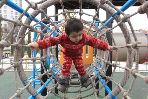 Mariam, 3 y.o from Dushanbe, Tajikistan enjoys her time playing in the yard and exploring her climbing skills