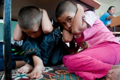 Children at a kindergarten in Kyrgyzstan take part in a drill to learn about safety in an emergency situation.