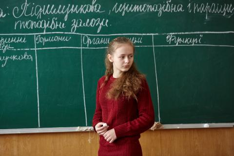 A ninth grade student, answers the teacher's question during a class at a school in eastern Ukraine near to the contact line.
