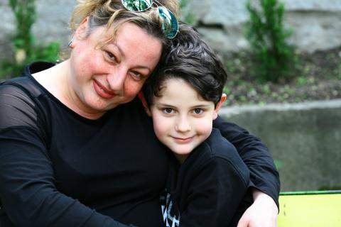 Six-year-old Vladi cuddles with his step mother in Bulgaria.