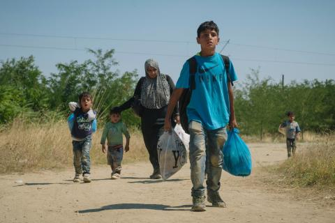 On 27 August, a group of people walk on dirt road near the town of Gevgelija in the former Yugoslav Republic of Macedonia.
