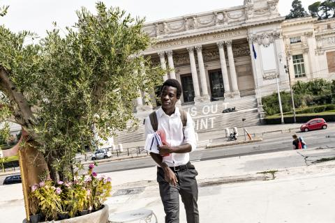 Ibrahim Kondeh, a 20-year-old from Sierra Leone, stands outside the Galleria Nazionale d'Arte Moderna in Rome