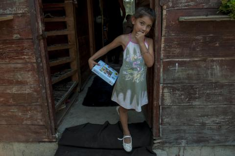 Girl in front of her house in a Roma settlement.
