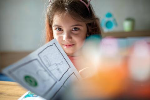 Masha, 9, draws a comic in her sketchbook