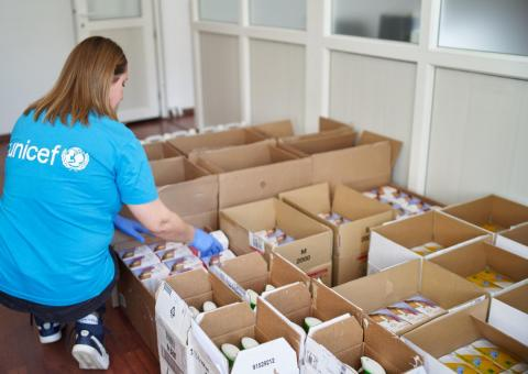 UNICEF project assistant checks gloves packs