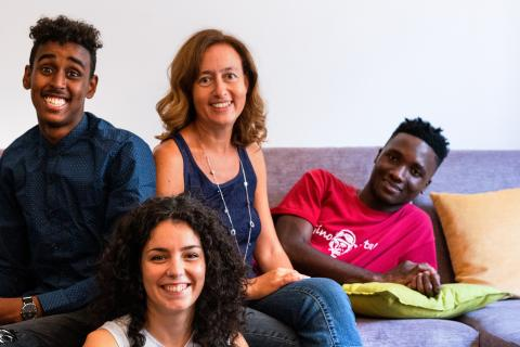 Farah and Sekou, two young migrants from Somalia and Guinea, with their Italian mentors, Francesca and Annalisa