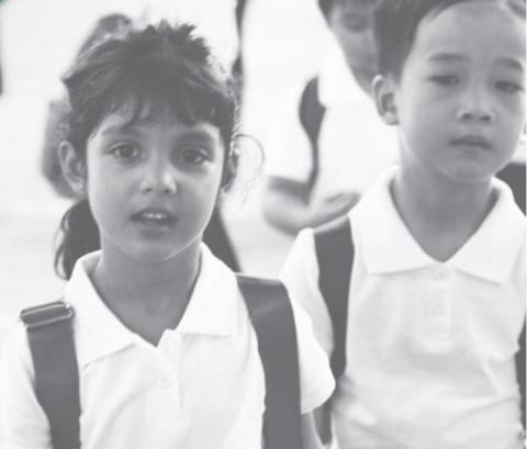 A boy and a girl wearing backpacks at school