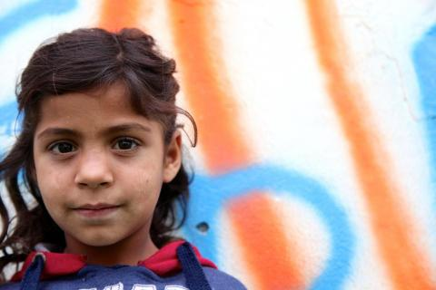 Headshot of a Roma girl looking directly at the camera