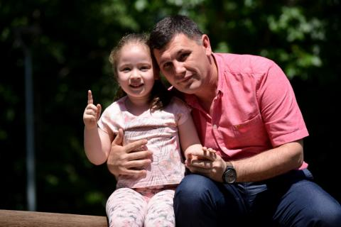Pavel Nikov, 42, with his daughter Paola, 4 and half years old.