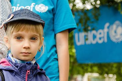 A conflict-affected girl takes part in a celebration of the International Children's Day in Svyatohirsk, eastern Ukraine. The event was organized by the Community Protection Centre supported by UNICEF.