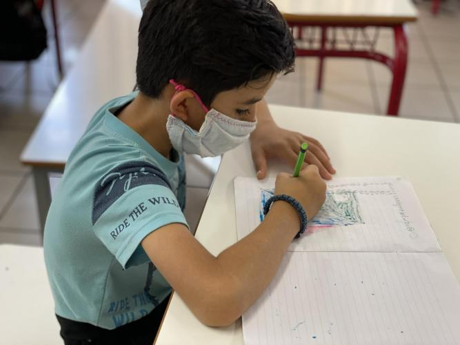 Children at the UNICEF supported ELIX Learning Center in Athens