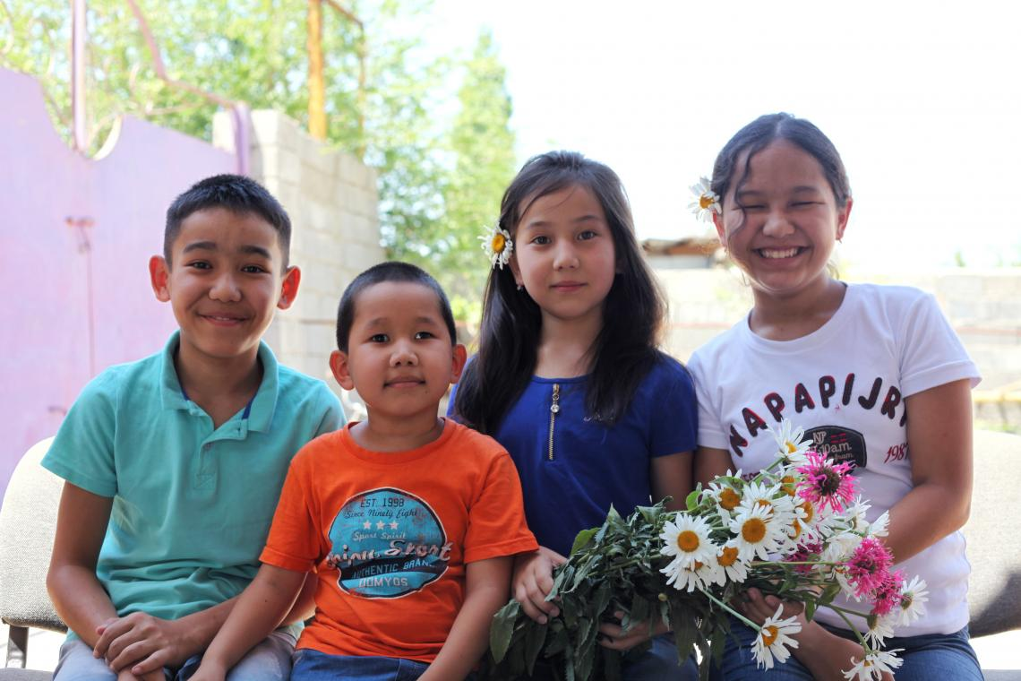Baurzhan with his sibling at the family home.