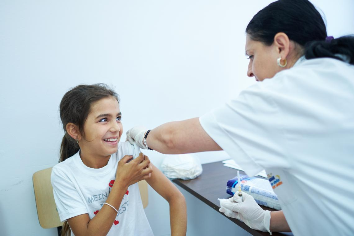 A girl is vaccinated at a community center in Buhuși, in Eastern Romania as part of the UNICEF and WHO supported immunization catch-up campaign.