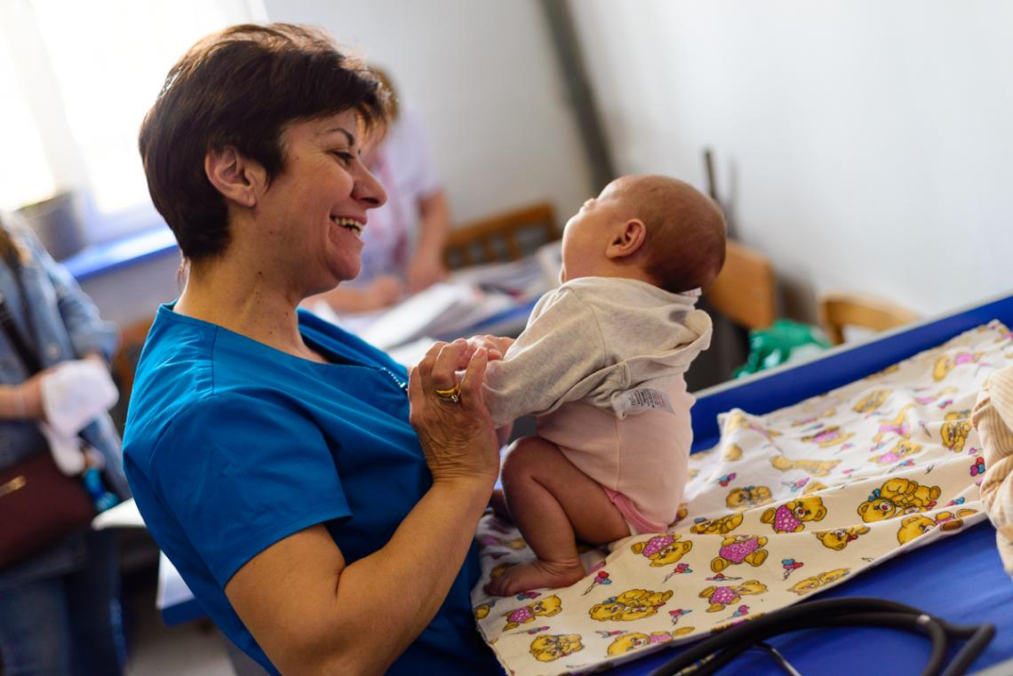 Dr. Sakanyan, a pediatrician, holding a new-born in a clinic in Lori Region, Armenia.