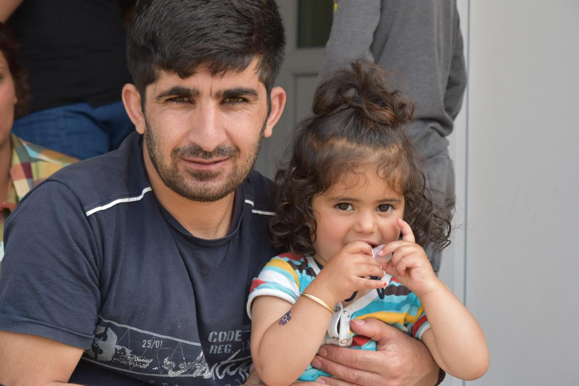 A refugee father and his daughter share a cuddle at a UNICEF-supported refugee centre in Sarajevo, Bosnia and Herzegovina.