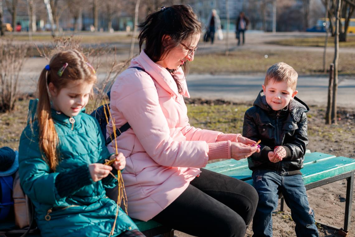 Natalia with her two children in a park in Kyiv.
