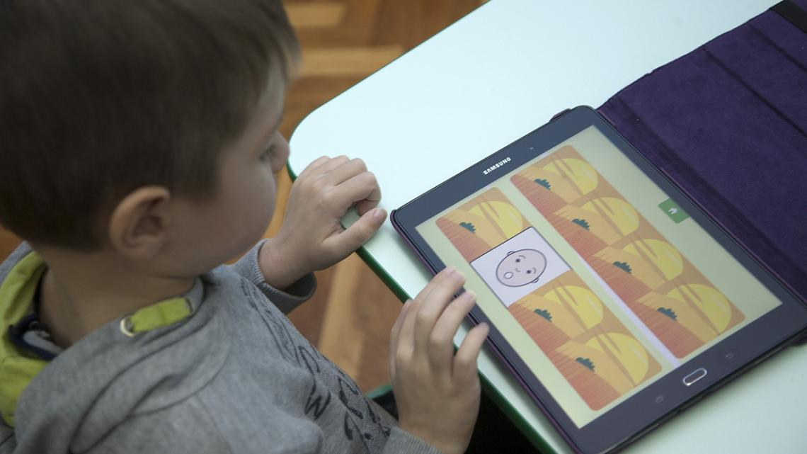 Patrik, who is on the autism spectrum, uses his tablet computer to help with communicating.