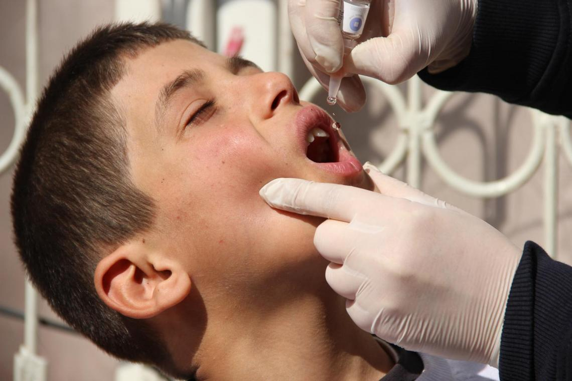 In Turkey, a boy receives a dose of the Oral Polio Vaccine (OPV).