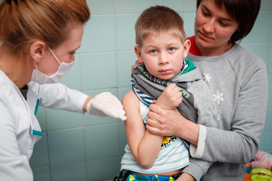 A young boy puts on a brave face as he receives his second dose of the MMR vaccine in Kyiv, Ukraine.