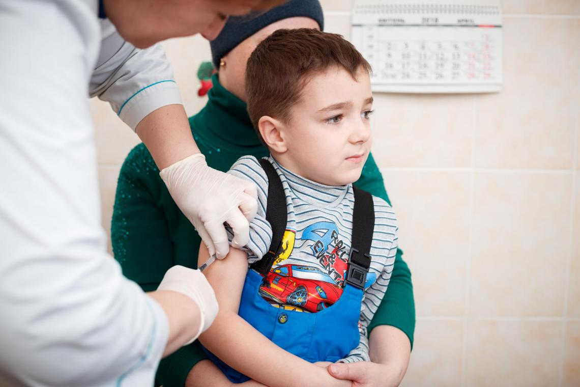 A young boy receives several vaccines at a time at Dr Natalia Yatsenko clinic in Kyiv.