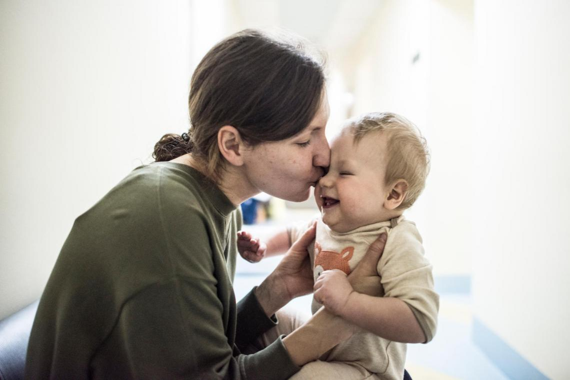 Nine-month-old Sasha gets a kiss from his mother, after receiving the diphtheria, pertussis, tetanus (DTP) vaccine in Kyiv.