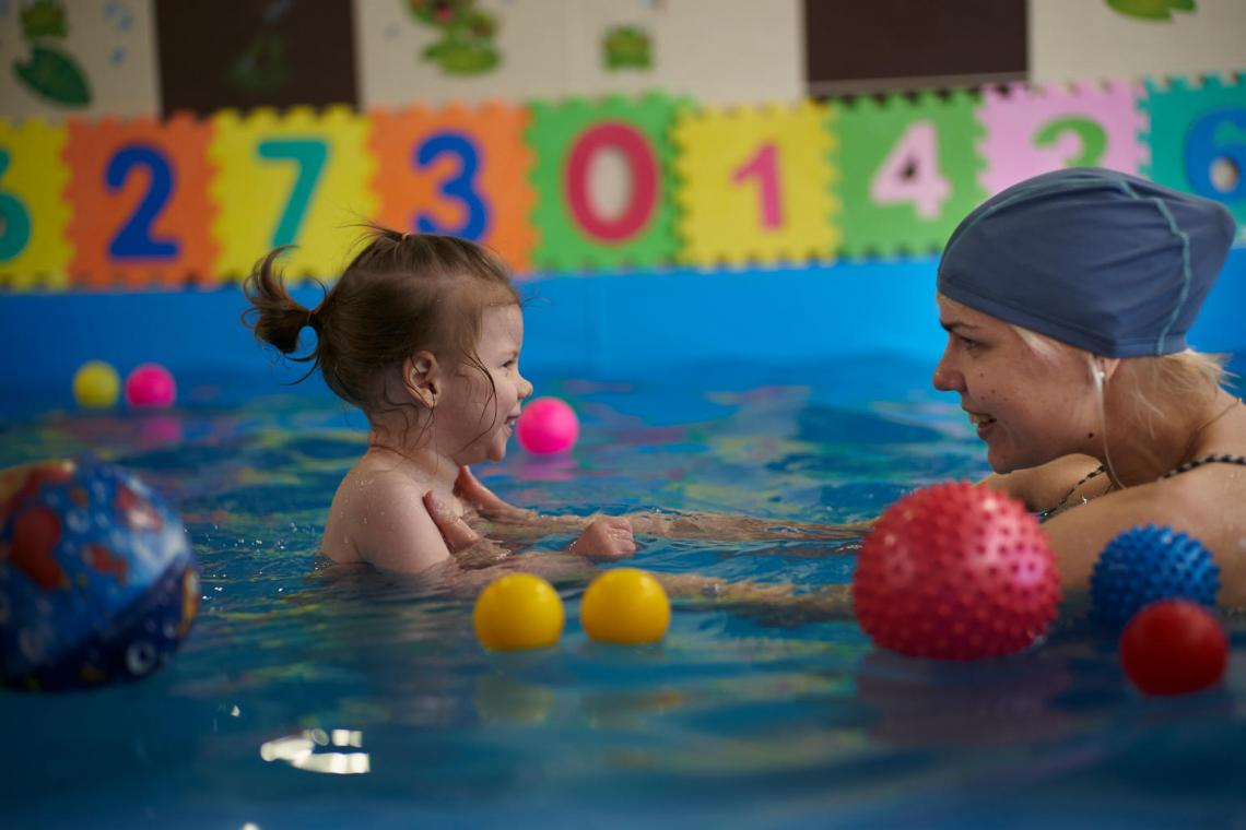Agatha exercises during an aquatherapy session with Svetlana, a rehabilitation swim teacher, at a swimming pool with facilities for children with disabilities, in Minsk, Belarus.