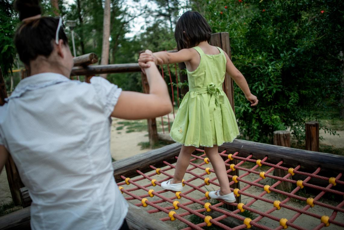 Jeta, 24, and Fabliona, 4, play in a park in Tirana, Albania, on June 8, 2018.