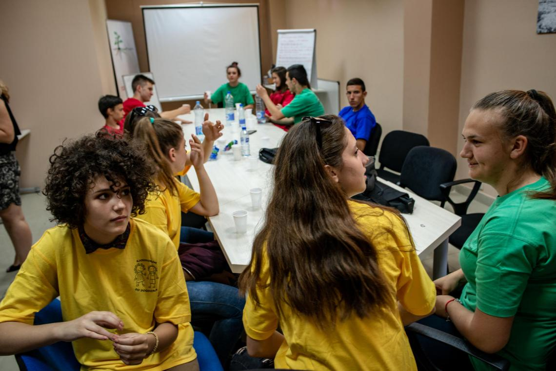 Snezana (on the left, in a yellow shirt) and her fellow peer mediators meet at the Peer Mediation Center of Domovik NGO, in Mitrovica North Kosovo (SCR 1244). UNICEF estimates approximately half of all students aged 13 to 15 globally – 150 million girls and boys – experience peer-violence. The peer mediators are student volunteers who are trained to resolve conflict at school – often cases of bullying and psychological abuse.