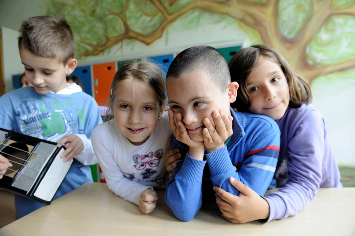 Children pose for a photo at an inclusive school in Belgrade, Serbia.