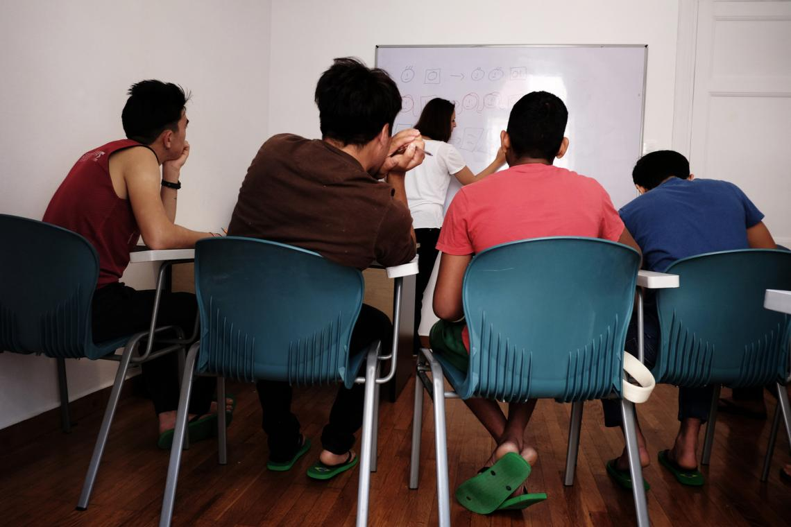 Unaccompanied children attend a Greek language course at a shelter for unaccompanied children in Athens, Greece.
