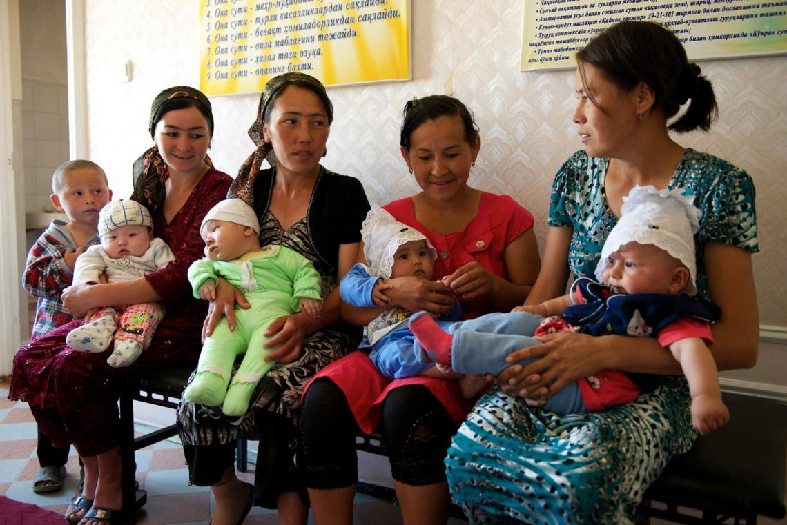 A group of women wait for their children to be vaccinated at a village clinic in Uzbekistan.