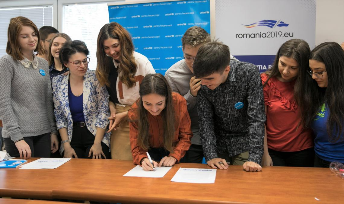 Members of the Romanian Children's Board sign a letter addressed to EU leaders calling for inclusion of children children in decision-making processes.