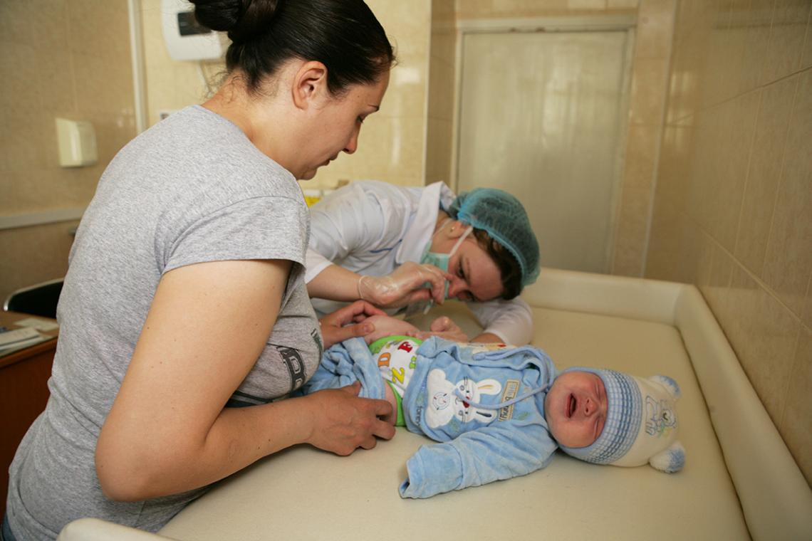 A little boy cries as he receives a routine vaccination at a clinic in Moldova.