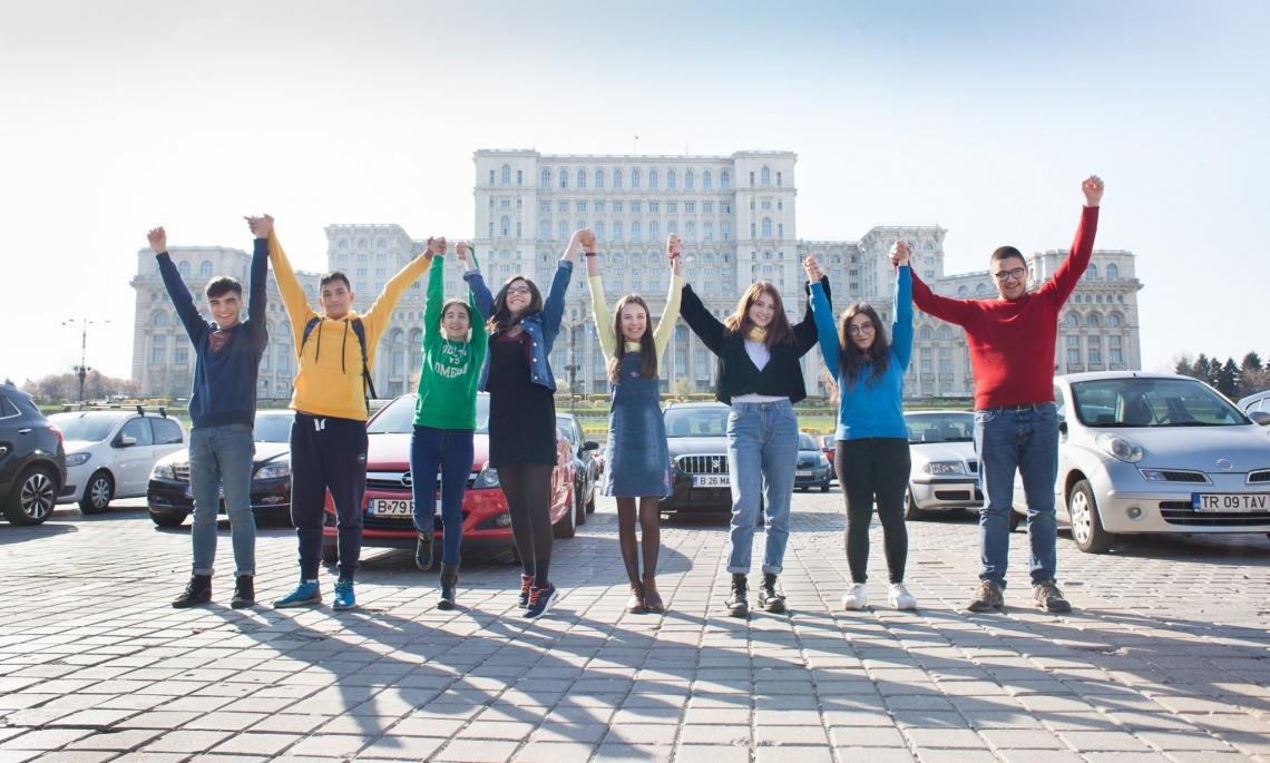 Members of the Romanian Children's Board together in front of the Romanian Parliament.