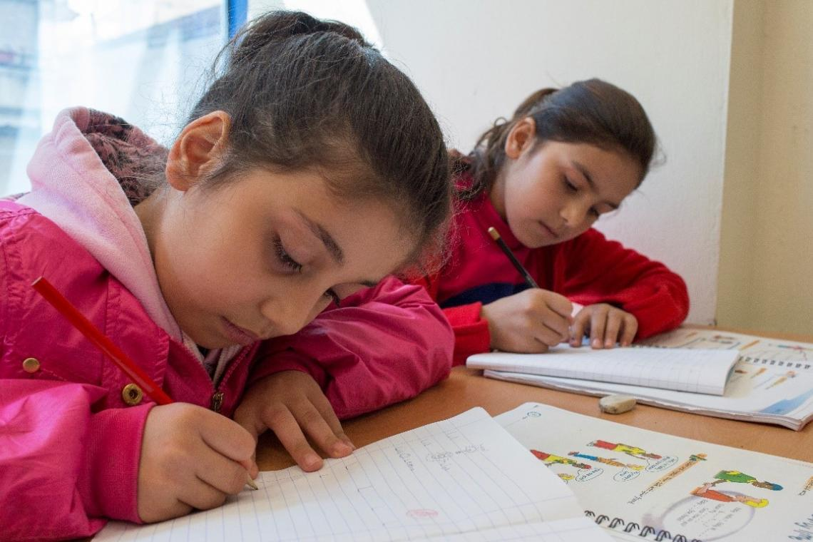 Shahed, 8, from Syrian, and Hadia, 9, from Afghanistan, at a UNICEF-supported education centre in Ioannina, Greece.