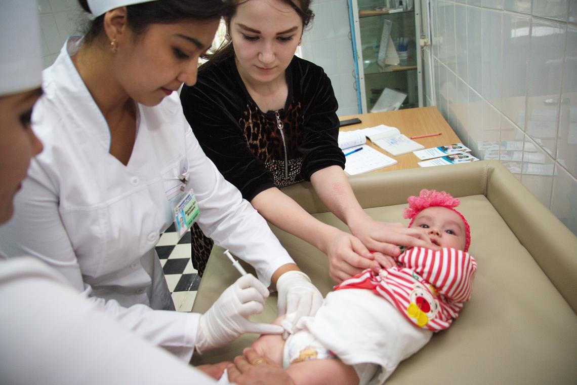 A young baby receives her vaccination injection in Uzbekistan.