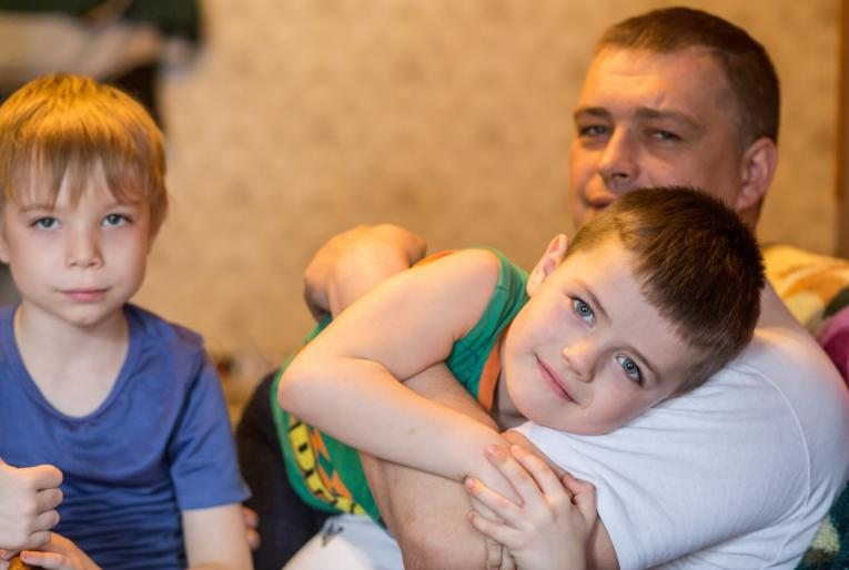 A father and his two sons at an apartment they share with his sister in Ukraine