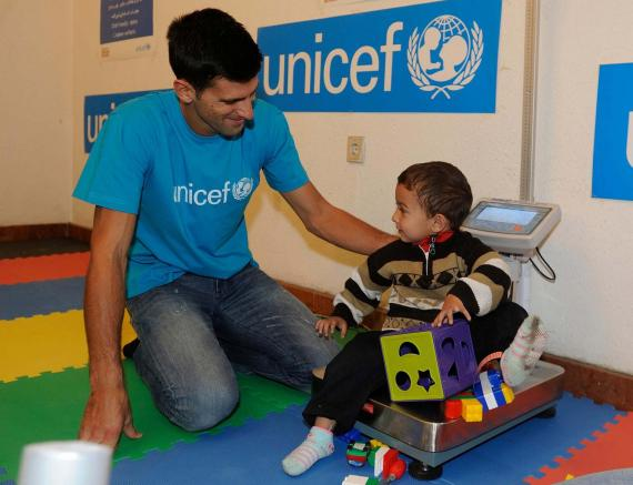 Djokovic playing with a young boy in Serbia.