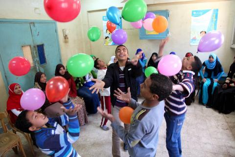 February 2014, City of Assiut, Upper Egypt. UNICEF assisted Dewina Youth Centre. Children attend a session on civic education. They discuss and play in group.