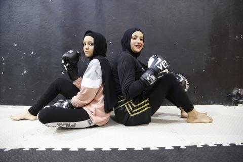 How do these girls use Thai boxing to fight their fear of harassment and violence?