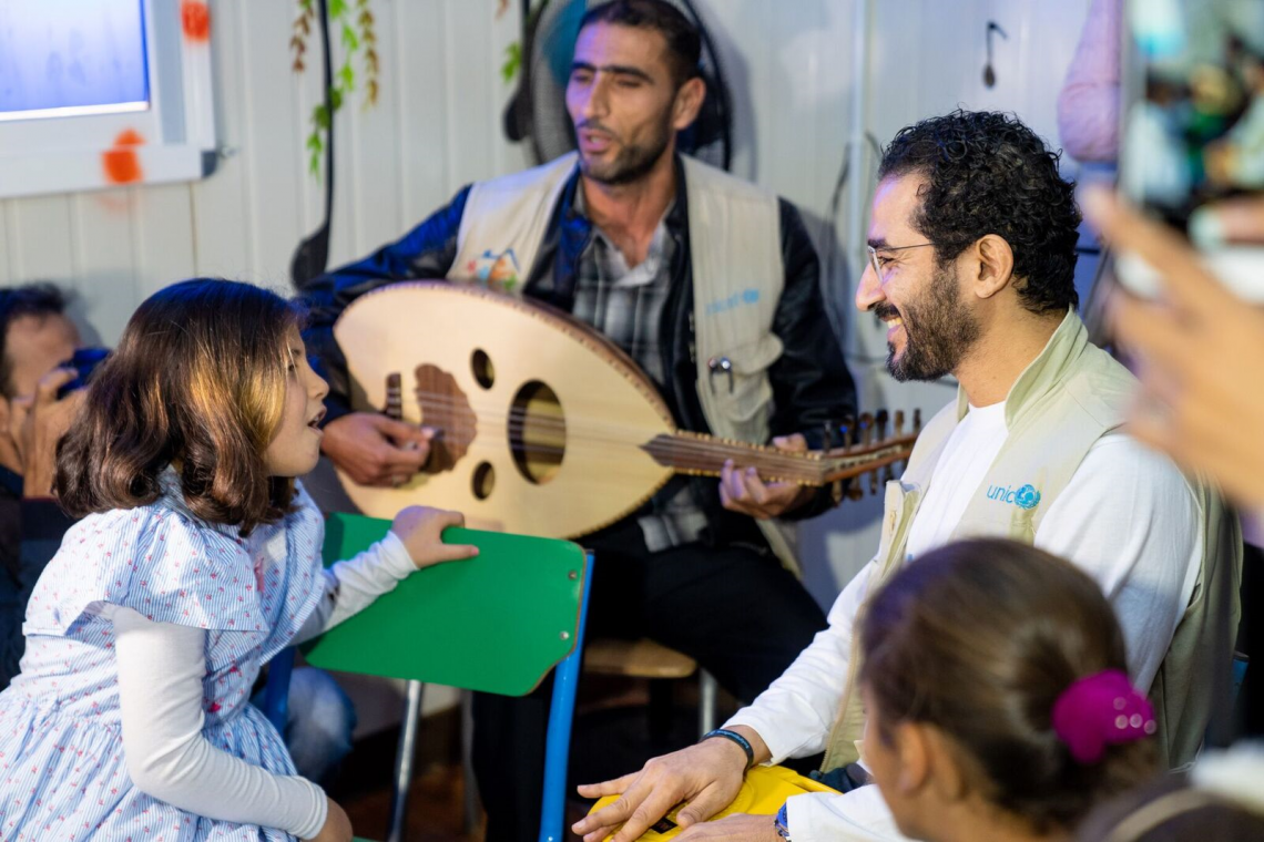 "Helmy met with Nour, a 9-year-old girl. They crooned together accompanied by a group of young girls, a famous song from the Syrian folklore. Singing helps those children. It is an integral part of the specialized program ""Mosikaty"" [My music], designed to assist children at the camp."