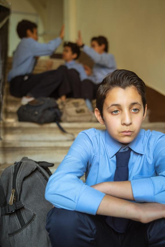 What are the warning signs of bullying?