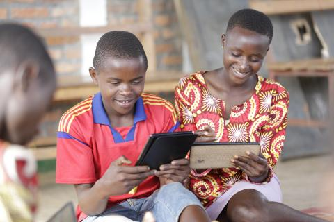 Alain Schadrack, 14, plays with educational apps in one of Mahama Camp's child-friendly spaces for Burundian refugee children.