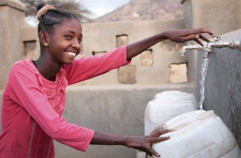 A girl collects water