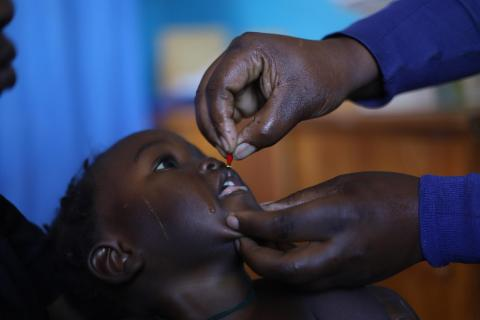 A child receives a drop of oral vaccine