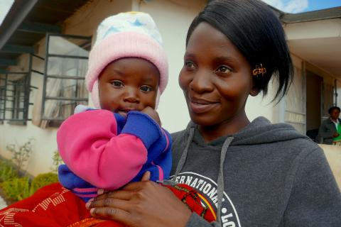 A mother and child after birth registration in Zambia